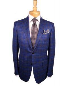 Ermenegildo Zegna sport coat and tie, Eton dress shirt and Edward Aramah pocket round.