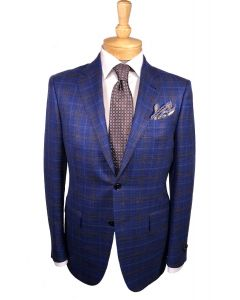 Ermenegildo Zegna sport coat and tie, Eton dress shirt and Edward Aramah pocket round.
